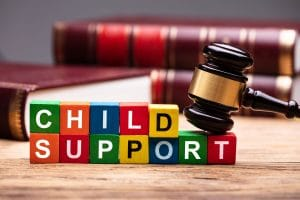 Child Support spelled out in children's blocks