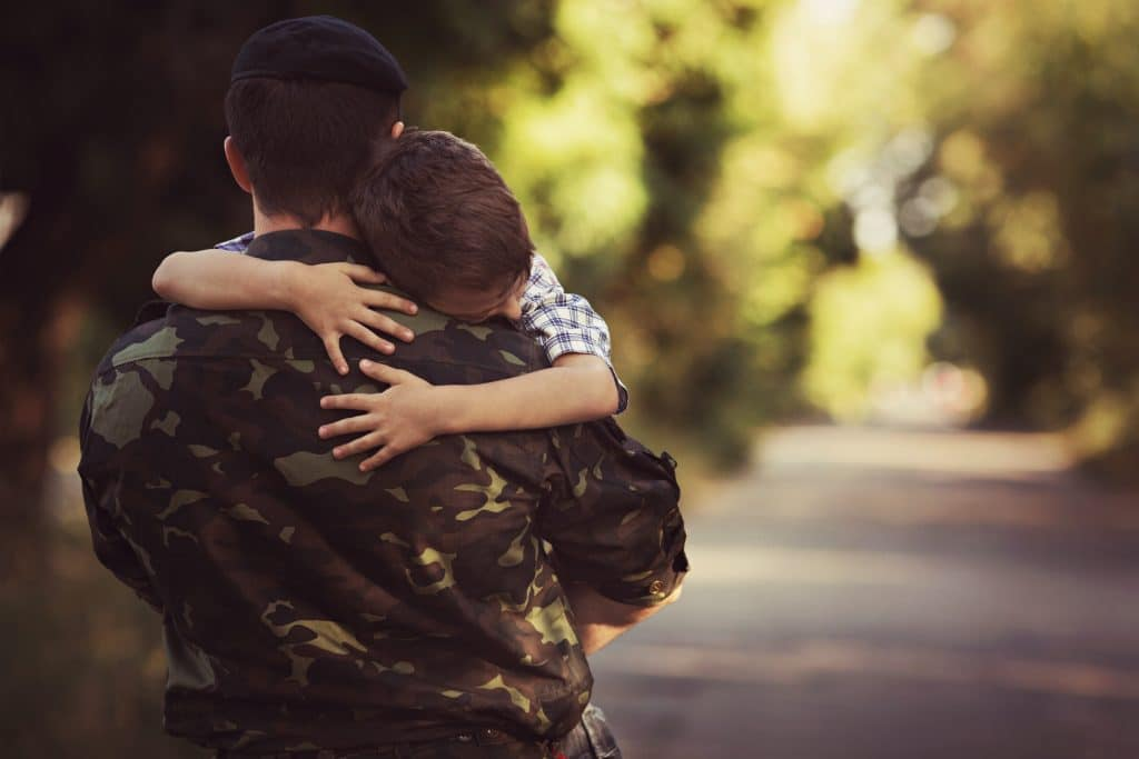 Soldier hugging child in TX